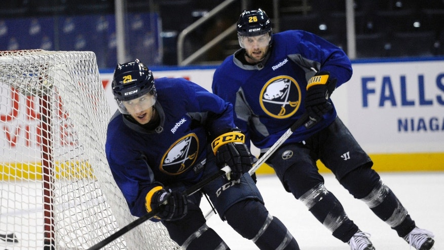 Buffalo Sabres' Jason Pominville and  Thomas Vanek skate sprints around the net  during the first day of the NHL hockey training camp in Buffalo, New York on Sunday, Jan. 13, 2013. (AP Photo/Gary Wiepert)