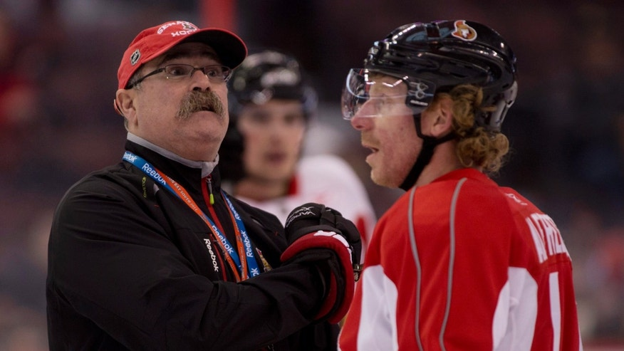 Ottawa Senators Captain Daniel Alfredsson, of Sweden,  talks with head coach Paul MacLean during NHL hockey training camp in Ottawa, Ontario, Thursday, Jan. 17, 2013. (AP Photo/The Canadian Press, Adrian Wyld)