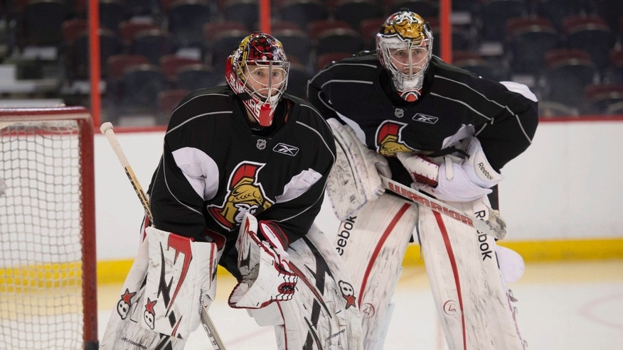 Ottawa Senators goalie Craig Anderson, left,  stands in the goal crease with Ben Bishop during NHL hockey training camp in Ottawa, Ontario, Thursday, Jan. 17, 2013. (AP Photo/The Canadian Press, Adrian Wyld)