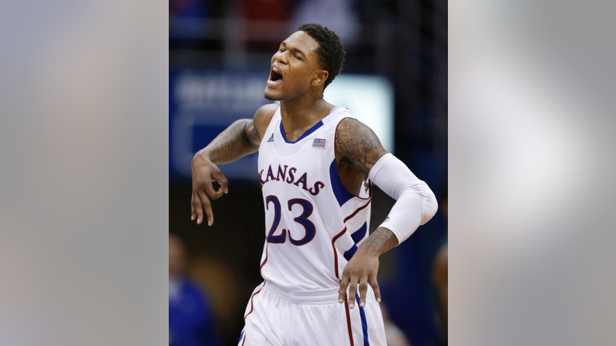 Kansas guard Ben McLemore celebrates a 3-point basket during the second half of an NCAA college basketball game against Baylor in Lawrence, Kan., Monday, Jan. 14, 2013. Kansas defeated Baylor 61-44. (AP Photo/Orlin Wagner)