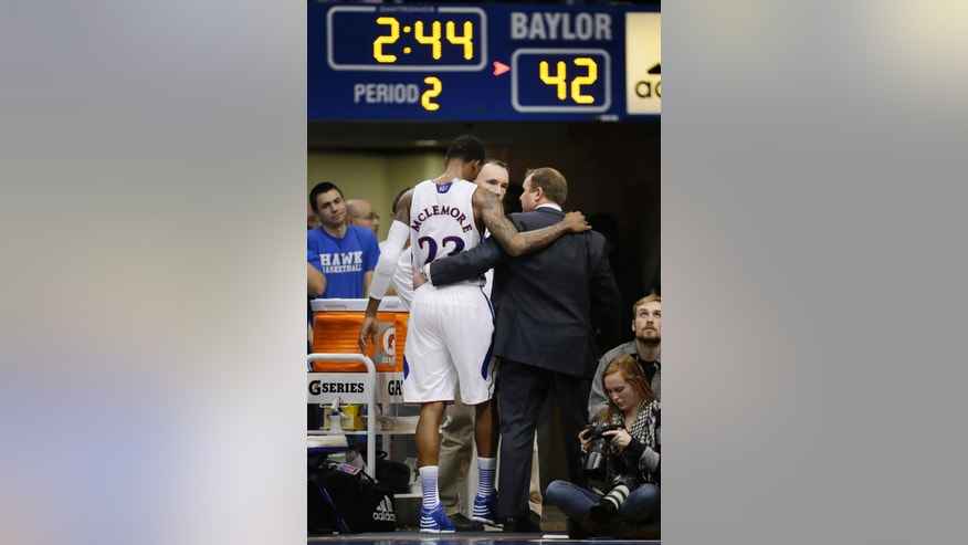 Kansas guard Ben McLemore is helped from the floor after an injury during the second half of an NCAA college basketball game against Baylor in Lawrence, Kan., Monday, Jan. 14, 2013. Kansas defeated Baylor 61-44. (AP Photo/Orlin Wagner)