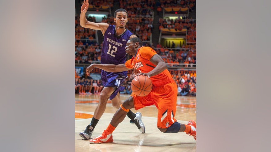 Illinois guard Brandon Paul, right, tries to move past Northwestern forward Jared Swopshire (12) during the first half of an NCAA college basketball game on Thursday, Jan. 17, 2013, in Champaign, Ill. (AP Photo/Darrell Hoemann)