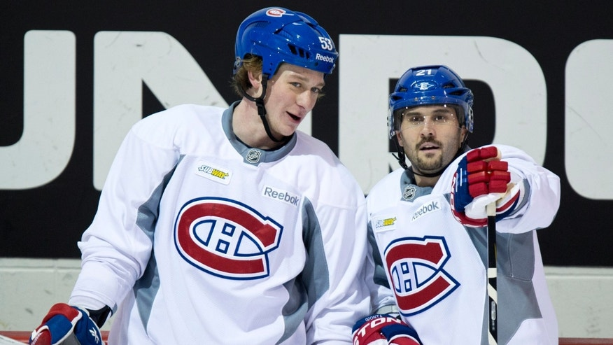 Montreal Canadiens Ryan White, left, chats with team captain Brian Gionta during NHL hockey training camp Wednesday, Jan. 16, 2013 in Brossard, Quebec. (AP Photo/The Canadian Press, Paul Chiasson)