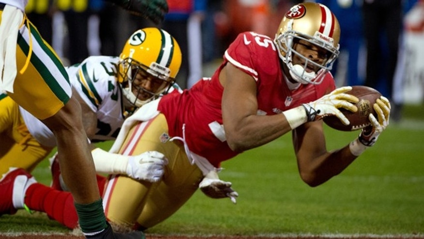 Jan. 12, 2013: San Francisco 49ers' Michael Crabtree dives into the end zone for a touchdown under pressure from Green Bay Packers San Shields during the second quarter of during an NFC divisional playoff NFL football game in San Francisco.