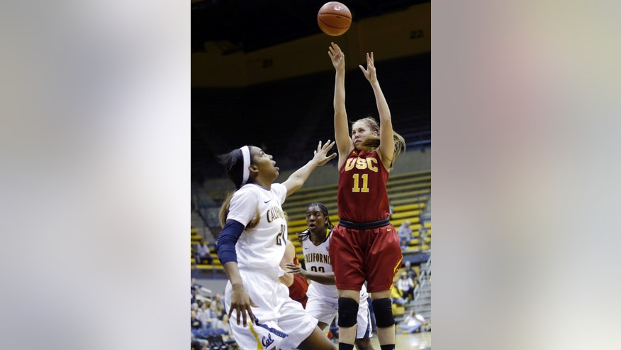 Southern California's Cassie Harberts (11) shoots against California's Reshanda Gray, left, during the first half of an NCAA college basketball game in Berkeley, Calif., Thursday, Jan. 17, 2013. (AP Photo/Marcio Jose Sanchez)