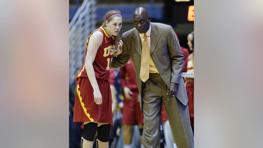 Southern California head coach Michael Cooper talks with forward Cassie Harberts during the first half of an NCAA college basketball game against California in Berkeley, Calif., Thursday, Jan. 17, 2013. (AP Photo/Marcio Jose Sanchez)