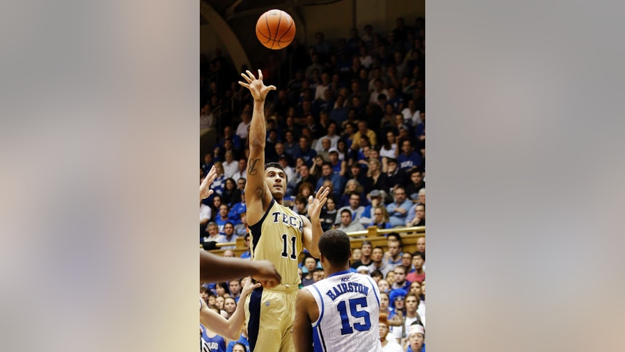 Georgia Tech's Chris Bolden (11) shoots over Duke's Josh Hairston (15) during the second half of an NCAA college basketball game in Durham, N.C., Thursday, Jan. 17, 2013. Duke won 73-57. (AP Photo/Gerry Broome)
