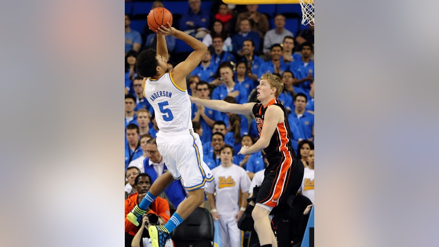 UCLA guard Kyle Anderson (5) shoots over Oregon State guard Olef Scahftenaar (30), of the Netherlands, in the first half of an NCAA college basketball game in Los Angeles, Thursday, Jan. 17, 2013. (AP Photo/Reed Saxon)