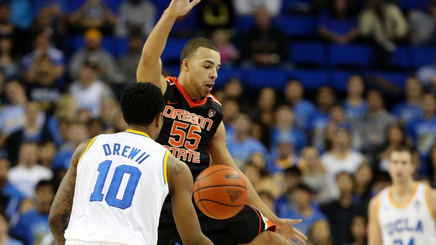 Oregon State guard Roberto Nelson (55) blocks a pass by UCLA guard Larry Drew II (10) in the first half of an NCAA college basketball game in Los Angeles, Thursday, Jan. 17, 2013. (AP Photo/Reed Saxon)