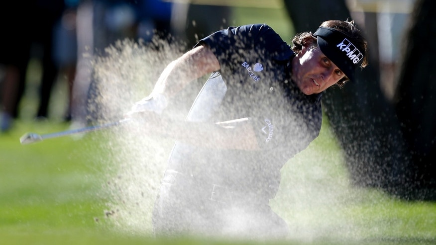 Phil Mickelson hits from a fairway bunker on the fifth hole during the first round of the Humana Challenge golf tournament at the La Quinta Country Club in La Quinta, Calif.,  Thursday, Jan. 17, 2013. (AP Photo/Chris Carlson)