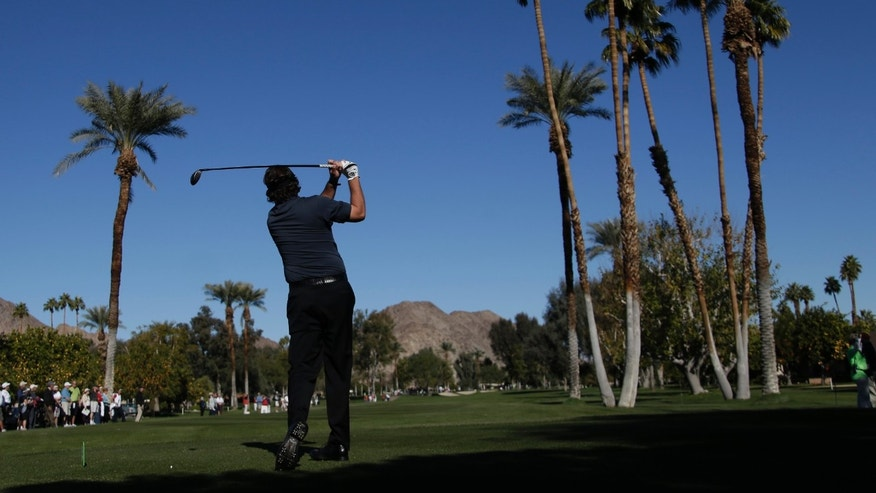 Phil Mickelson watches his tee shot on the fifth hole during the first round of the Humana Challenge golf tournament at the La Quinta Country Club in La Quinta, Calif., Thursday, Jan. 17, 2013. (AP Photo/Chris Carlson)