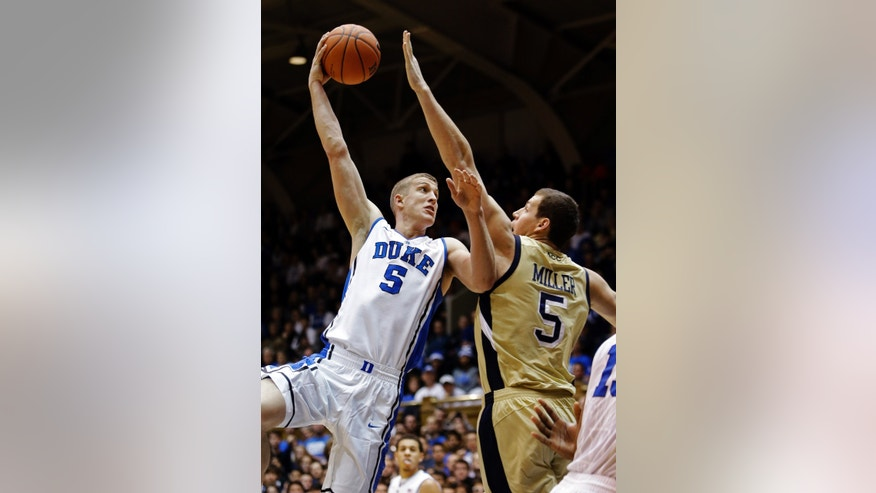 Duke's Mason Plumlee (5) shoots over Georgia Tech's Daniel Miller (5) during the first half of an NCAA college basketball game in Durham, N.C., Thursday, Jan. 17, 2013. (AP Photo/Gerry Broome)