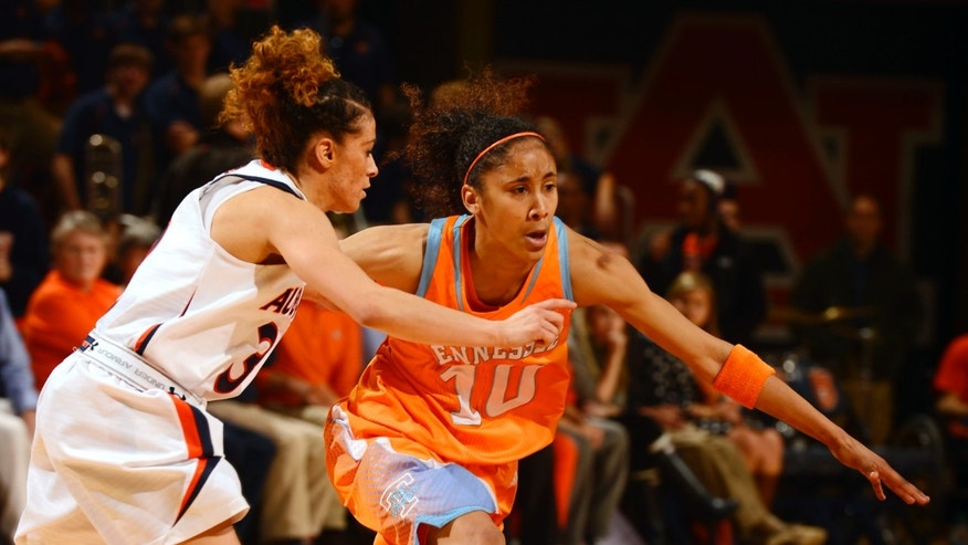 Tennessee's Meighan Simmons dribbles around Auburn's Najat Ouardad in the first half of their NCAA women's college basketball game on Thursday, Jan. 17, 2013, in Auburn, Ala. (AP Photo/Todd J. Van Emst)