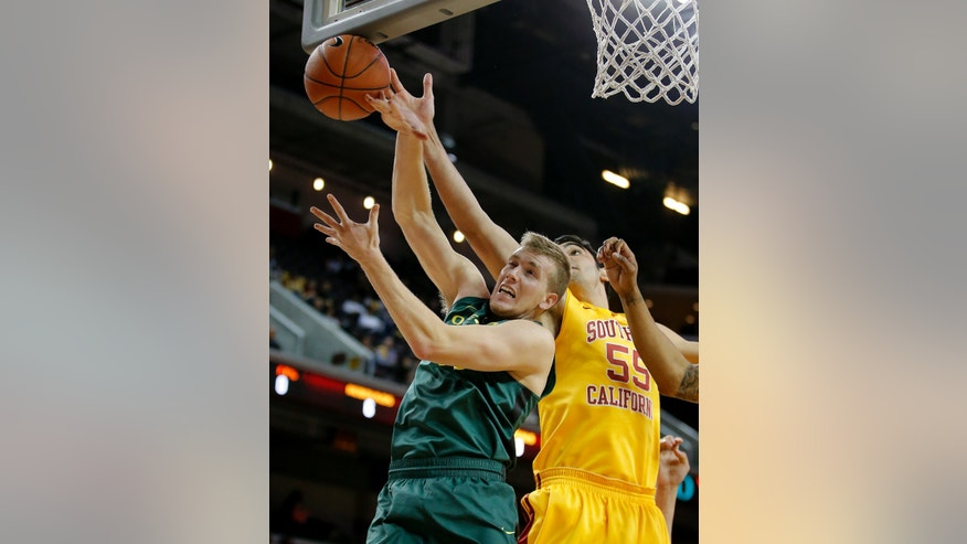 Oregon's E.J. Singler, left, and Southern California's Omar Oraby fight for a rebound during the first half of an NCAA college basketball game in Los Angeles, Thursday, Jan. 17, 2013. (AP Photo/Jae C. Hong)