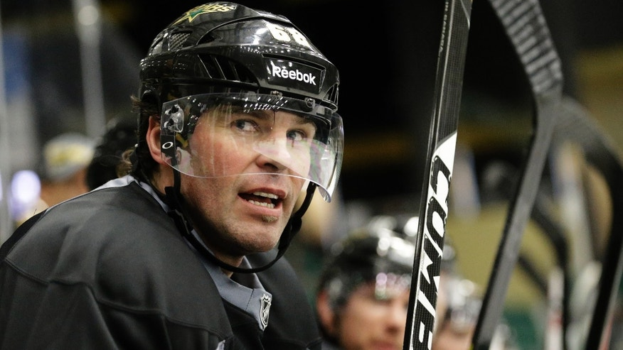 Dallas Stars right wing Jaromir Jagr (68) watches from the bench during NHL hockey training camp in Frisco, Texas, Tuesday, Jan. 15, 2013. (AP Photo/LM Otero)