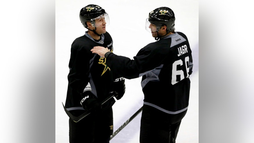 Dallas Stars defenseman Stephane Robidas (3) listens to right wing Jaromir Jagr (68) during NHL hockey training camp in Frisco, Texas, Tuesday, Jan. 15, 2013. (AP Photo/LM Otero)