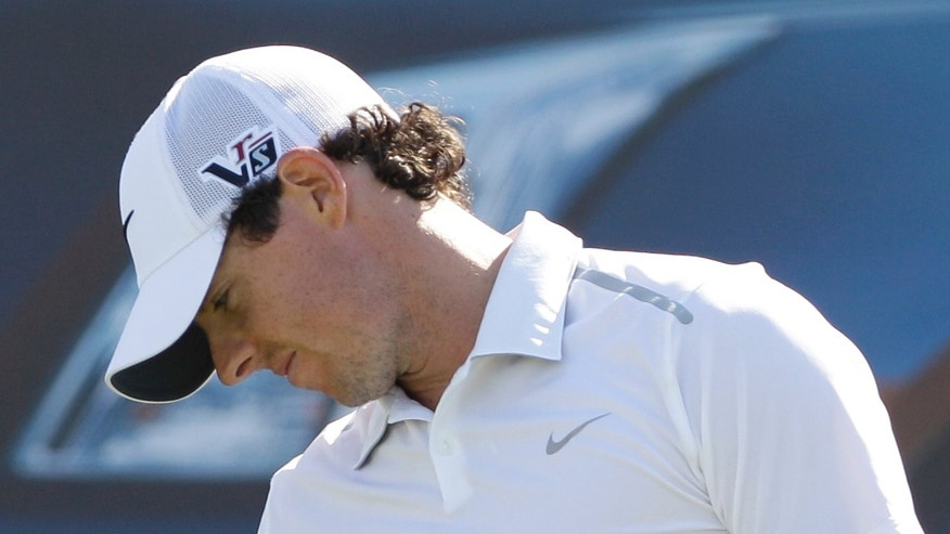 Rory McIlroy from Northern Ireland reacts on the 7th hole during the second round of Abu Dhabi Golf Championship in Abu Dhabi, United Arab Emirates, Friday, Jan. 18, 2013. (AP Photo/Kamran Jebreili)