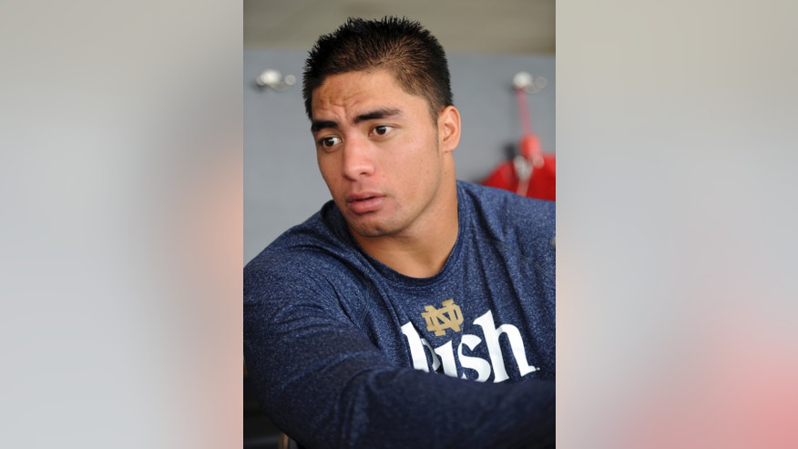 FILE - In this Aug. 16, 2012, file photo, Notre Dame linebacker Manti Te'o answers a question during NCAA college football media day in South Bend, Ind. The wrenching story of Te'o's girlfriend dying of leukemia _ a loss he said inspired him to play his best all the way to the BCS championship _ was dismissed by the school Wednesday, Jan. 16, 2013, as a hoax perpetrated against the linebacker. (AP Photo/Joe Raymond, File)