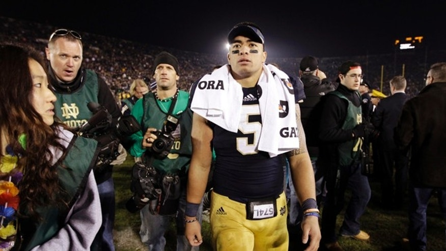 Nov. 17, 2012: In this file photo, Notre Dame linebacker Manti Te&#39&#x3b;o walks off the field following an NCAA college football game against Wake Forest in South Bend, Ind.
