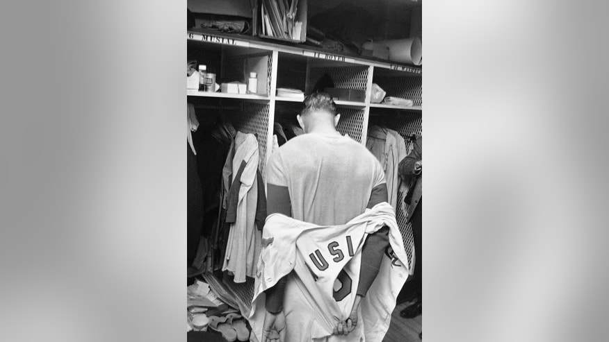 FILE- In this Sept. 29, 1963 file photo, St. louis Cardinals' Stan Musial takes off his uniform in the clubhouse as he completes his playing career after a baseball game against the Cincinnati Reds in St. Louis. Musial, one of baseball's greatest hitters and a Hall of Famer with the Cardinals for more than two decades, died Saturday, Jan. 19, 2013, the team announced. He was 92. (AP Photo/File)