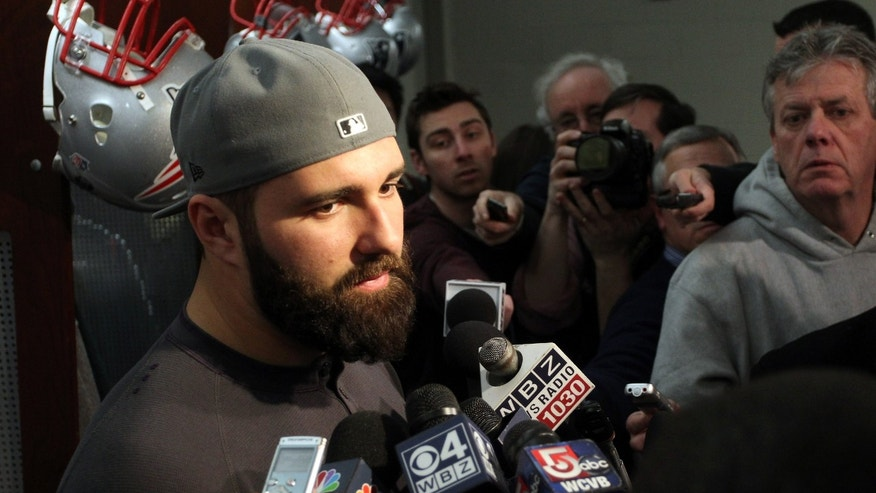 New England Patriots defensive end Rob Ninkovich, left, talks with the media in the locker room at Gillette Stadium in Foxborough, Mass., Monday, Jan. 21, 2013. The Patriots wrap up their season after Sunday's night's loss to the Baltimore Ravens in the AFC Championship game. (AP Photo/Stew Milne)