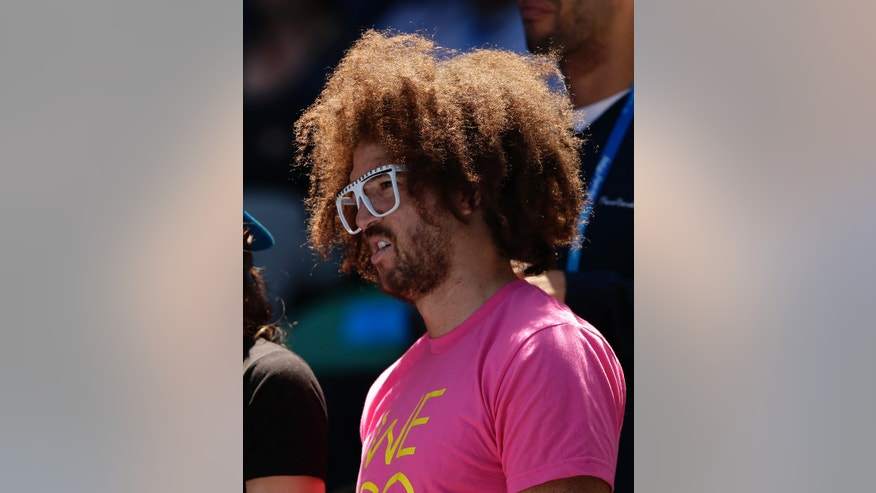 American rapper Redfoo watches Belarusian Victoria Azarenka's third round match against Madison Keys of the US at the Australian Open tennis championship in Melbourne, Australia, Saturday, Jan. 19, 2013. Azarenka, well known for her loud on-court shrieks, will have them recognized after Redfoo recorded and mixed them into a new song. (AP Photo/Andy Wong)