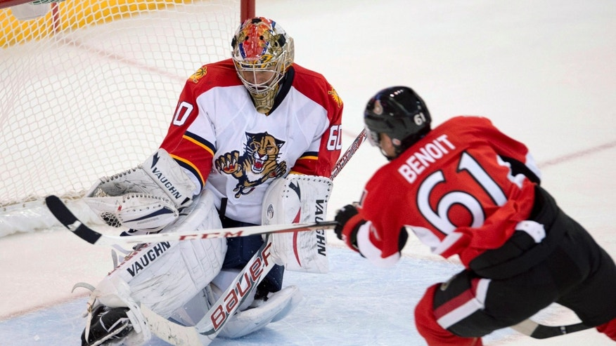 Ottawa Senators left wing Andre Benoit takes a shot on Florida Panthers goalie Jose Theodore during the third period of an NHL hockey game in Ottawa, Ontario, Monday, Jan. 21, 2013. (AP Photo/The Canadian Press, Adrian Wyld)