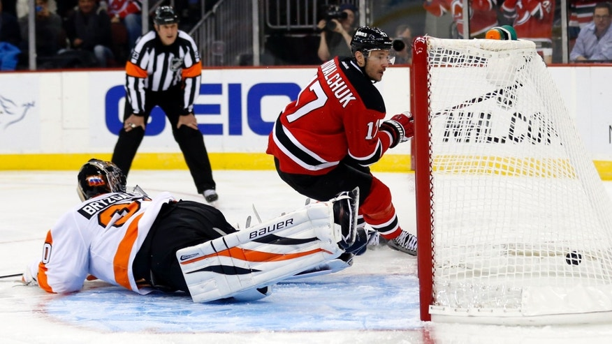 New Jersey Devils left wing Ilya Kovalchuk (17), of Russia, scores on a penalty shot against Philadelphia Flyers goalie Ilya Bryzgalov, of Russia, during the second period of an NHL hockey game, Tuesday, Jan. 22, 2013, in Newark, N.J. (AP Photo/Julio Cortez)