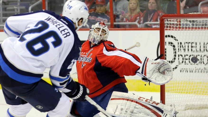 Winnipeg Jets right wing Blake Wheeler (26) watches his shot go past Washington Capitals goalie Braden Holtby (70) for a goal in the second period of an NHL hockey game Tuesday, Jan. 22, 2013 in Washington. (AP Photo/Alex Brandon)