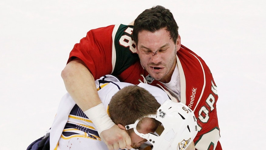 Minnesota Wild center Zenon Konopka (28) fights against Nashville Predators left wing Richard Clune (16) during the first period of an NHL hockey game Tuesday, Jan. 22, 2013 in St. Paul, Minn. (AP Photo/Genevieve Ross)