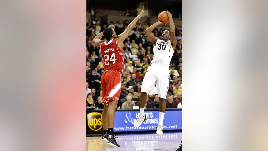 Wake Forest's Travis McKie (30) shoots over North Carolina State's T.J. Warren (24) during the first half of an NCAA college basketball game in Winston-Salem, N.C., Tuesday, Jan. 22, 2013. (AP Photo/Chuck Burton)