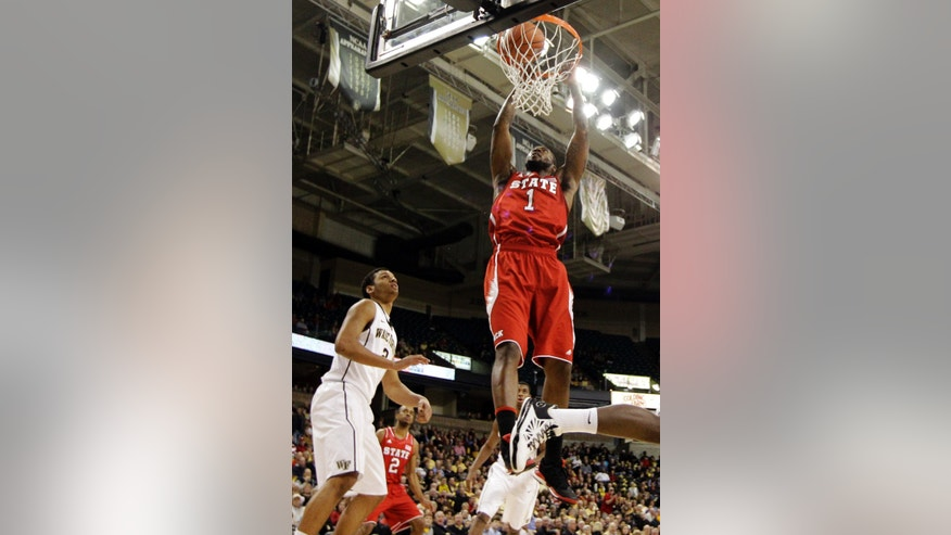 North Carolina State's Richard Howell (1) tries to dunk as Wake Forest's Devin Thomas (2) watches during the first half of an NCAA college basketball game in Winston-Salem, N.C., Tuesday, Jan. 22, 2013. (AP Photo/Chuck Burton)
