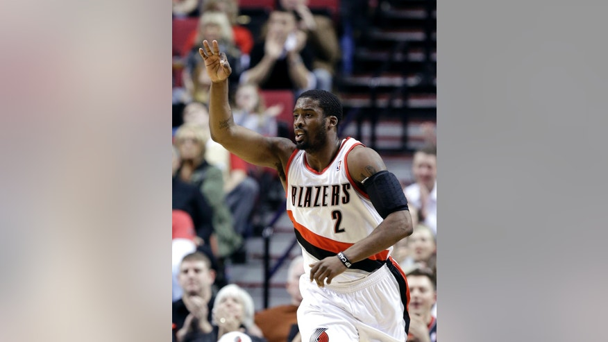 Portland Trail Blazers guard Wesley Matthews celebrates sinks a 3-point shot during the first quarter of an NBA basketball game against the Washington Wizards in Portland, Ore., Monday, Jan. 21, 2013. (AP Photo/Don Ryan)