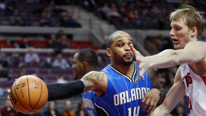 Orlando Magic guard Jameer Nelson (14) passes against Detroit Pistons forward Kyle Singler during the first half of an NBA basketball game Tuesday, Jan. 22, 2013, in Detroit. (AP Photo/Duane Burleson)