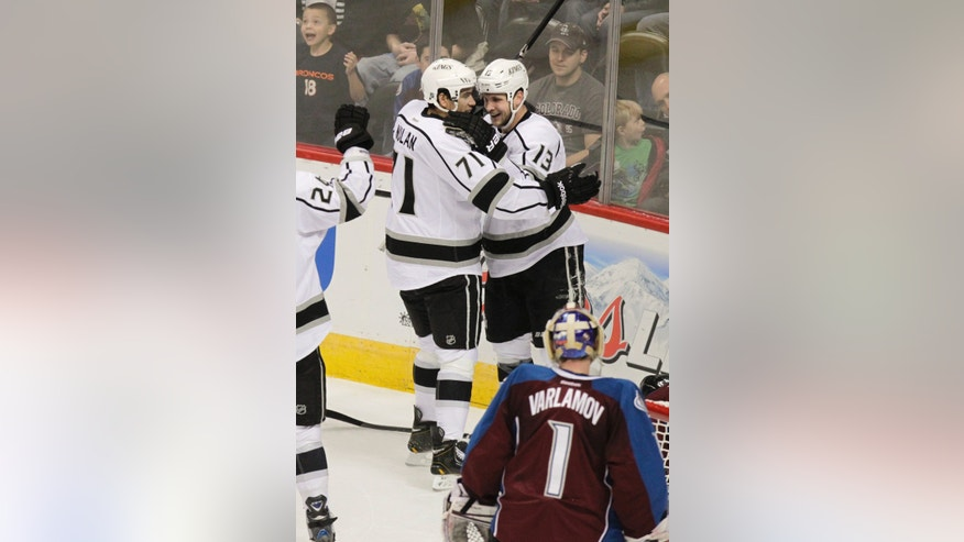 Los Angeles Kings' Kyle Clifford (13) celebrates a goal with teammate Jordan Nolan (71), who got the assist, while Colorado Avalanche goalie Semyon Varlamov, bottom, of Russia, watches during the first period of an NHL hockey game on Tuesday, Jan. 22, 2013 in Denver. (AP Photo/Barry Gutierrez)