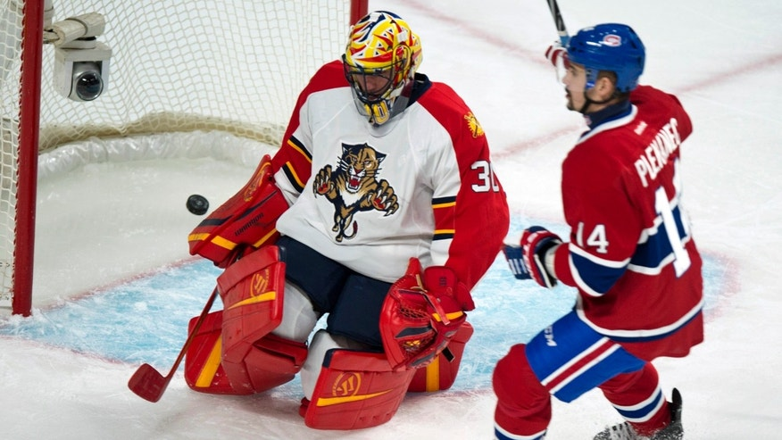 Montreal Canadiens' Tomas Plekanec, right, celebrates his goal past Florida Panthers goalie Scott Clemmensen during the first period of their NHL hockey game, Tuesday, Jan. 22, 2013, in Montreal. (AP Photo/The Canadian Press, Paul Chiasson)