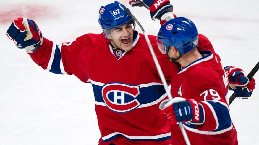 Montreal Canadiens' Max Pacioretty, left, congratulates Andrei Markov for his power play goal against the Florida Panthers during the first period of their NHL hockey game, Tuesday, Jan. 22, 2013, in Montreal. (AP Photo/The Canadian Press, Paul Chiasson)