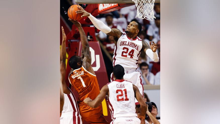 Oklahoma's Romero Osby (24) blocks a shot by Texas' Sheldon McClellan (1) as Oklahoma's Cameron Clark (21) watches during their NCAA college basketball game, Monday, Jan. 21, 2013, in Norman, Okla. (AP Photo/The Oklahoman, Nate Billings) LOCAL TV OUT (KFOR, KOCO, KWTV, KOKH, KAUT OUT); LOCAL INTERNET OUT; LOCAL PRINT OUT (EDMOND SUN OUT, OKLAHOMA GAZETTE OUT) TABLOIDS OUT