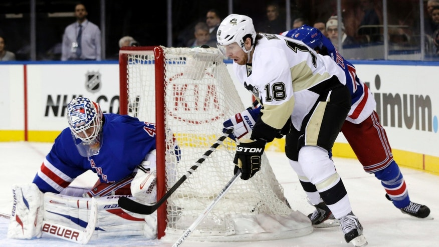 Pittsburgh Penguins' James Neal (18) shoots on New York Rangers goalie Martin Biron, left, while being chased by Michael Del Zotto during the third period of their NHL hockey game in New York, Sunday, Jan. 20, 2013. The Penguins won 6-3. (AP Photo/Seth Wenig)