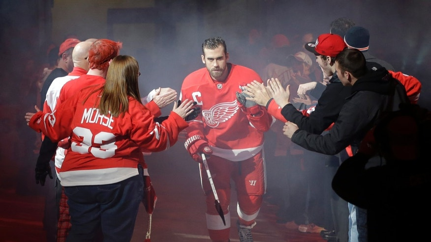 Detroit Red Wings center Henrik Zetterberg is introduced before the Red Wings' NHL hockey game against the Dallas Stars in Detroit, Tuesday, Jan. 22, 2013. (AP Photo/Carlos Osorio)