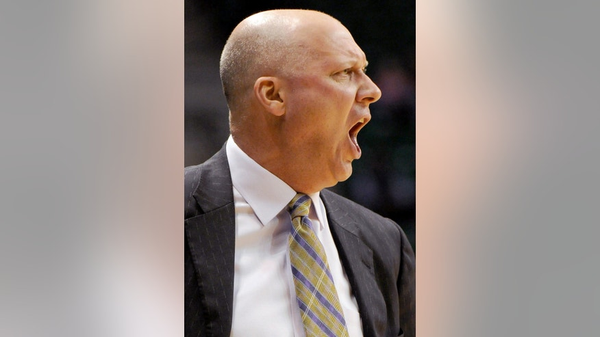 East Carolina Coach Jeff Lebo shouts instructions to his team in the first half of an NCAA college basketball game against UAB at Bartow Arena in Birmingham, Ala., Wednesday, Jan. 23, 2013.  (AP Photo/ AL.com, Mark Almond)