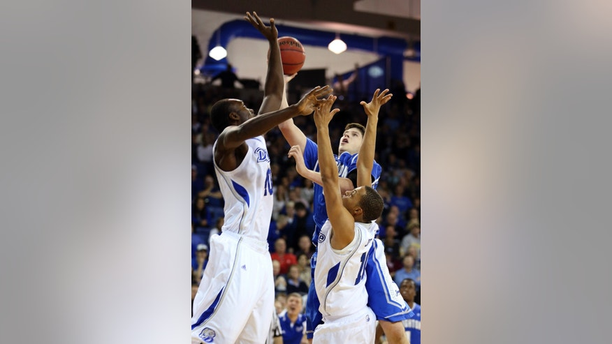 Creighton forward Doug McDermott, rear right, shoots over Drake forwards Daddy Ugbede, left, and Jeremy Jeffers during the first half of an NCAA college basketball game, Wednesday, Jan. 23, 2013, in Des Moines, Iowa. (AP Photo/Justin Hayworth)