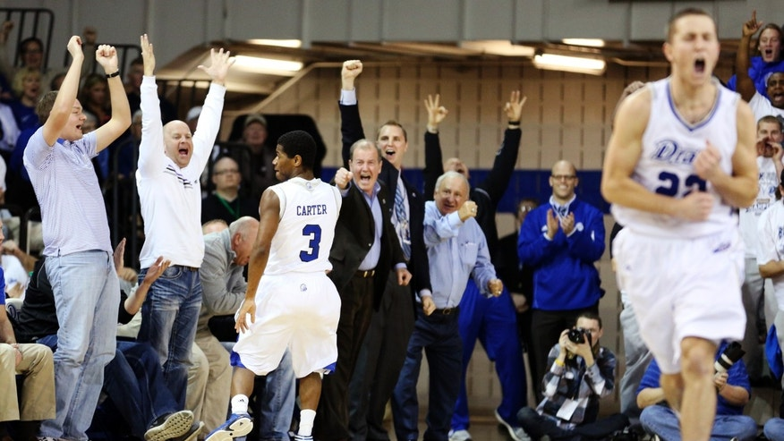 Drake fans cheer after a 3-pointer by guard Richard Carter during the first half of an NCAA college basketball game against Creighton, Wednesday, Jan. 23, 2013, in Des Moines, Iowa. (AP Photo/Justin Hayworth)