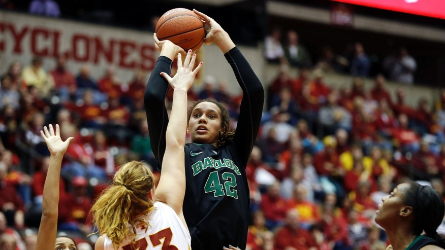 Baylor center Brittney Griner (42) shoots over Iowa State forward Chelsea Poppens (33) during the first half of an NCAA college basketball game, Wednesday, Jan. 23, 2013, in Ames, Iowa. Griner scored 22 points as Baylor won 66-51. (AP Photo/Charlie Neibergall)
