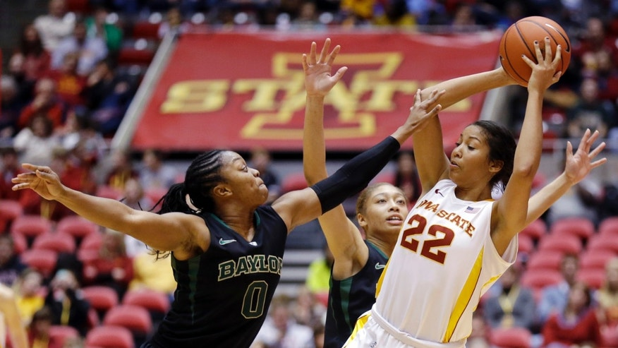Iowa State guard Brynn Williamson (22) looks to pass over Baylor's Odyssey Sims, left, and Alexis Prince, center, during the second half of an NCAA college basketball game, Wednesday, Jan. 23, 2013, in Ames, Iowa. Baylor won 66-51. (AP Photo/Charlie Neibergall)