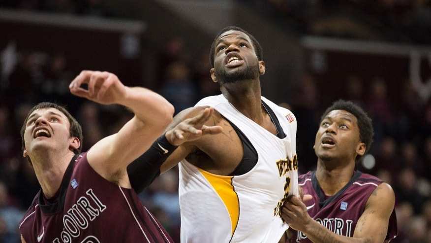 Wichita State forward Chadrack Lufile (0) is blocked out by Missouri State forward Christian Kirk (42) and Missouri State guard Marcus Marshall (11) during the first half of an NCAA college basketball game on Wednesday, Jan 23, 2013, in Springfield, Mo. (AP Photo/David Welker)