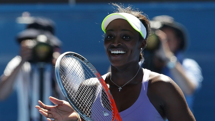 Sloane Stephens of the US celebrates after defeating compatriot Serena Williams in their quarterfinal match at the Australian Open tennis championship in Melbourne, Australia, Wednesday, Jan. 23, 2013.  (AP Photo/Aaron Favila)
