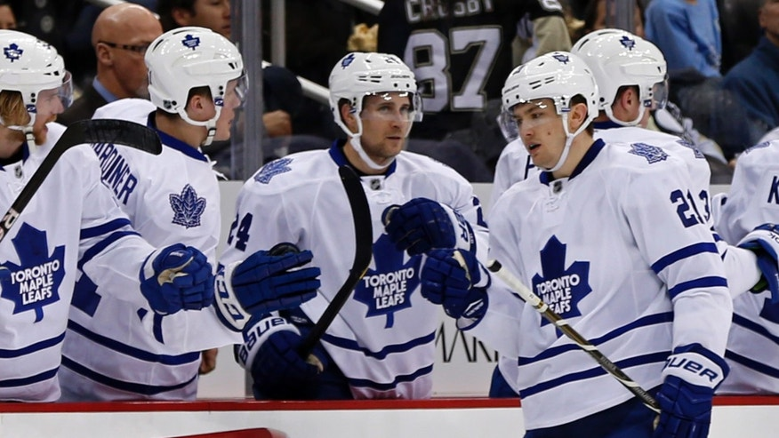 Toronto Maple Leafs left wing James van Riemsdyk (21) returns to the bench after scoring a second-period goal against the Pittsburgh Penguins during an NHL hockey game in Pittsburgh, Wednesday, Jan. 23, 2013. (AP Photo/Gene J. Puskar)