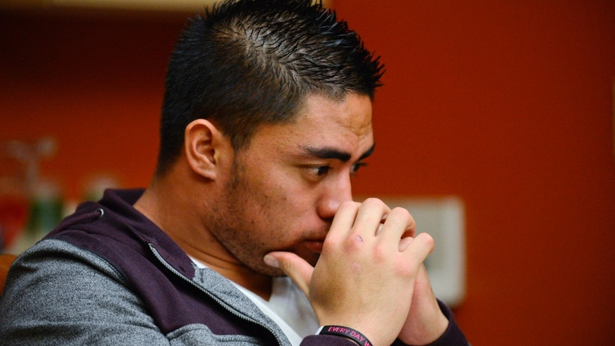 "In a photo provided by ESPN, Notre Dame linebacker Manti Te'o pauses during an interview with ESPN on Friday, Jan. 18, 2013, in Bradenton, Fla. ESPN says Te'o maintains he was never involved in creating the dead girlfriend hoax. He said in the off-camera interview: ""When they hear the facts they'll know. They'll know there is no way I could be a part of this."" (AP Photo/ESPN Images, Ryan Jones) MANDATORY CREDIT"