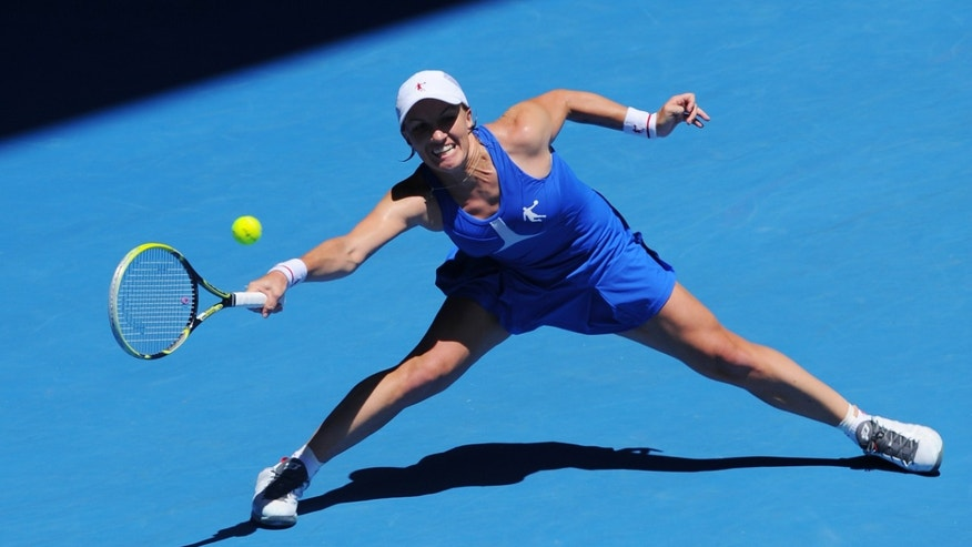 Russia's Svetlana Kuznetsova hits a forehand return to Victoria Azarenka of Belarus during their quarterfinal match at the Australian Open tennis championship in Melbourne, Australia, Wednesday, Jan. 23, 2013. (AP Photo/Andrew Brownbill)